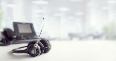 Headset headphones telephone on desk in call center